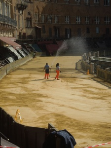 Watering down the track, just days before the Palio.